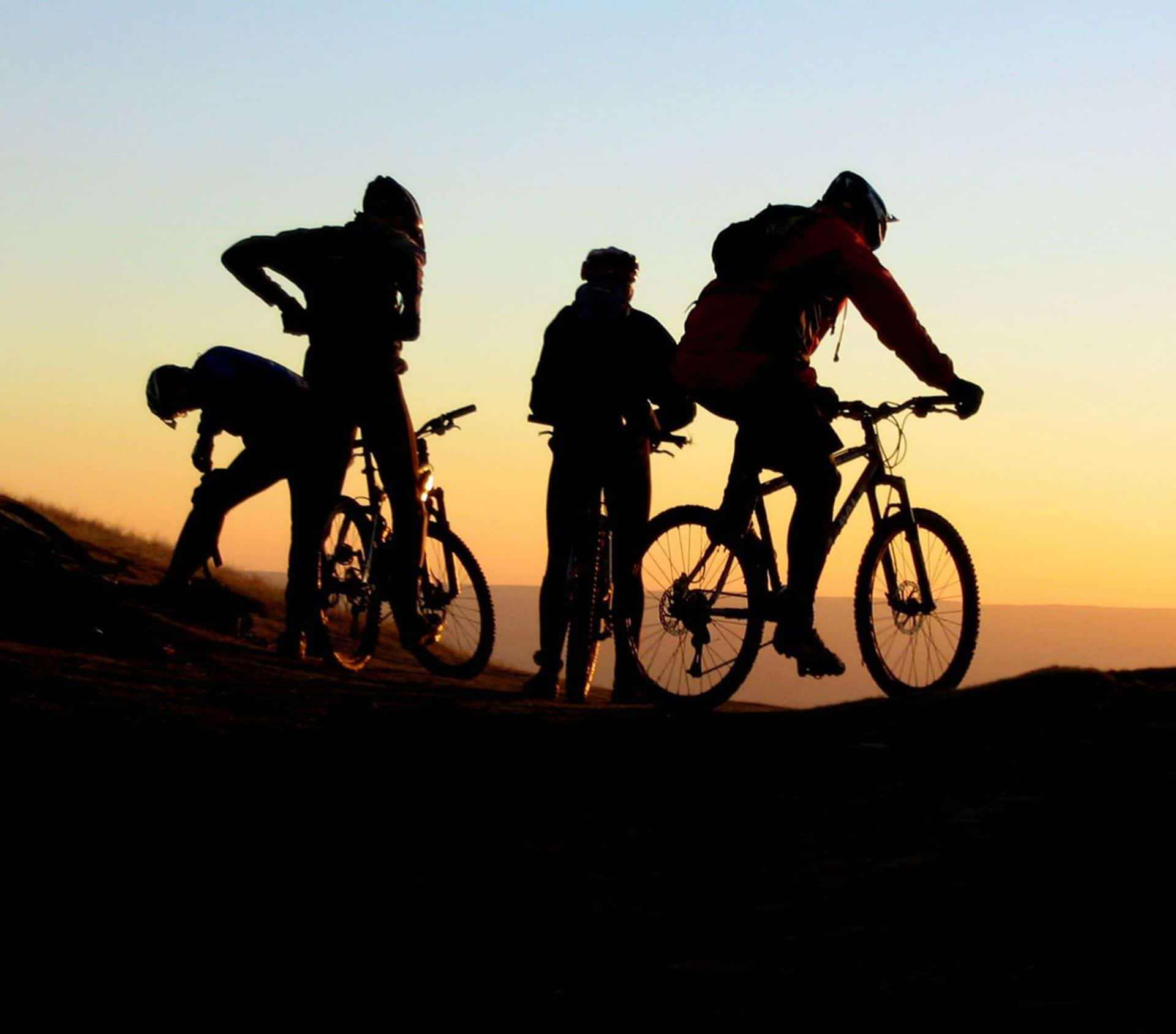 bikers with sunset